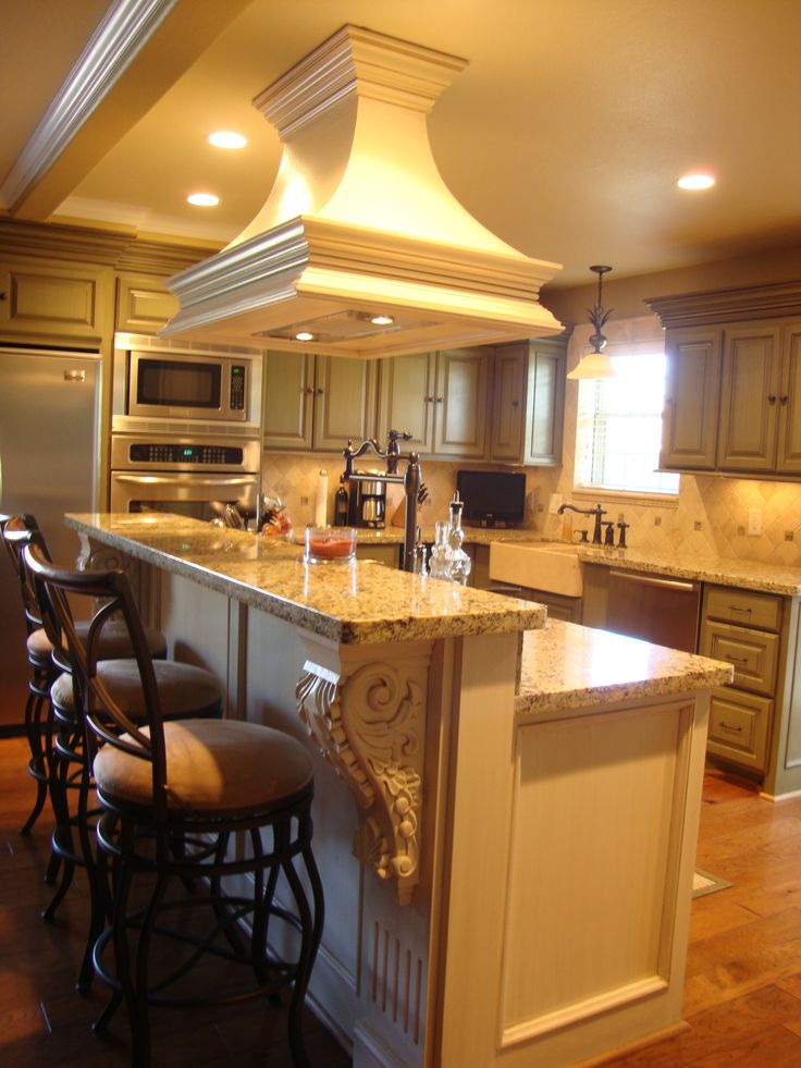custom kitchen , venthood over the island. Check my facebook page. Wendalyn Design