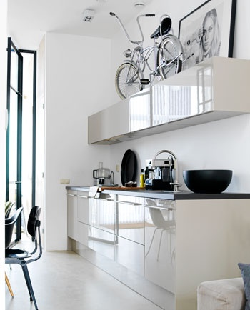 Shiny kitchen, interesting place to store your bike.