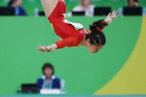 Aiko Sugihara of Japan competes on the floor during the women's team gymnastics final.