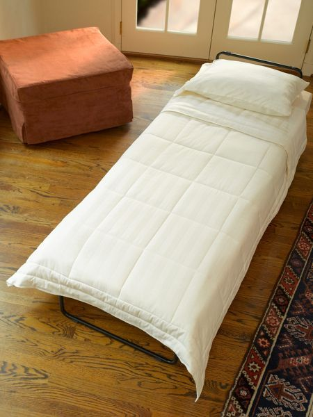 Ottoman by day bed by night put your feet up and relax for Where to put ottoman