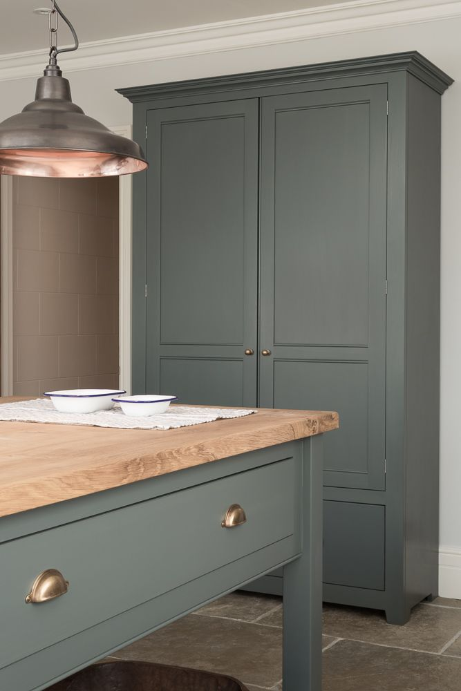 Autumn vibes with moody colour pallets and warm Bella Brass cup handles. The Hampton Court Kitchen by deVOL