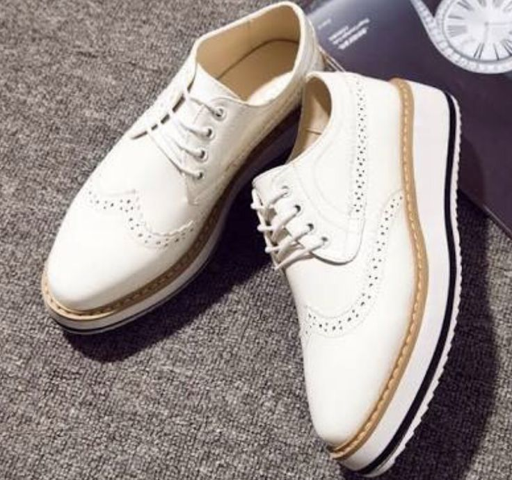 Simple white leather platform casuals with nude trim are made more formal with brogue detail whilst remaining practical for day activities. Very cute look with shorts, skirts and dresses. As well as capri pants or slim fit dress pants. Photo credit: a02shoes.com