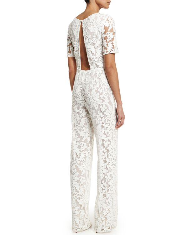 Open backed white lace pant suit @myweddingdotcom