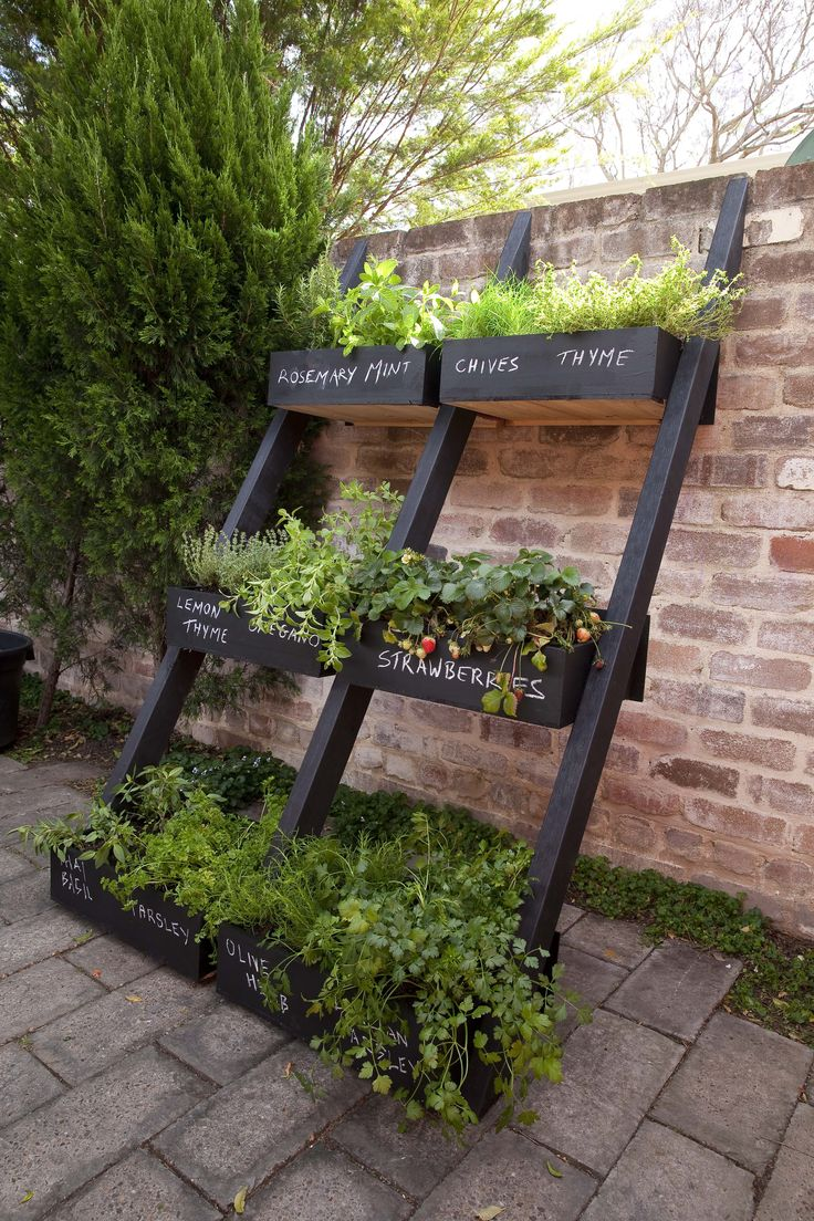 Take a look at what 'junk' you might have lying about that can easily be transformed into a DIY vertical garden system. Here, old drawers and lengths of timber are primed and painted in exterior paint, then fixed together to make a clever leaning herb garden. Top tip? Don't forget the drainage holes in each drawer!