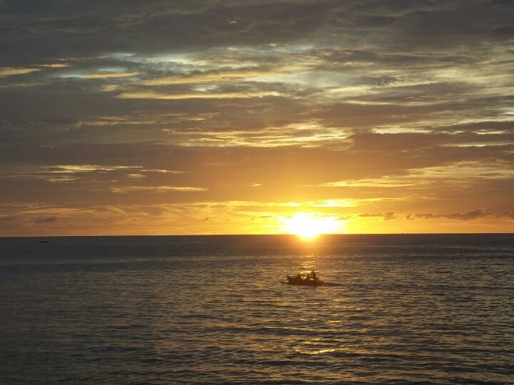 Fisherman's boat and sunset. (Location: Malalayang Beach, Manado, North Sulawesi.)