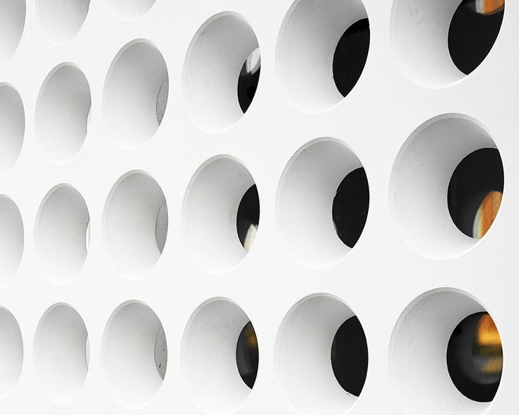 the perforated concrete façade elements are 7 cm thick, smooth on all sides and provide an interesting external view from the interior of the building  image © rieder smart elements