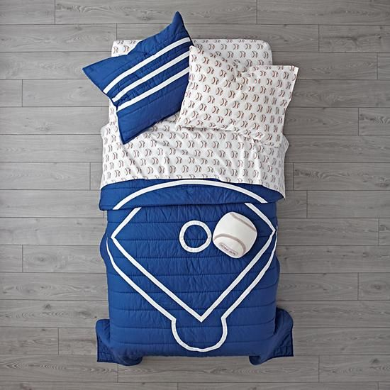 The Land of Nod Baseball Bedding is so great, it's ready to go pro. Made from comfy 100% cotton, the blue quilt is uniquely designed to resemble a baseball diamond. And the printed sheet set is made from 100% organic cotton.