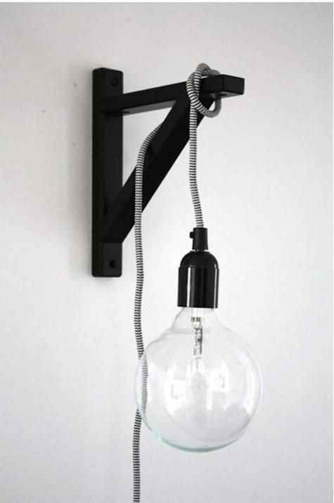 To avoid rewiring your entire place, you can also hang a corded lightbulb off of a wall-mounted shelf bracket.