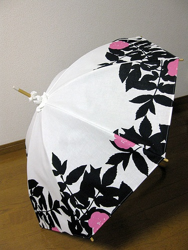 Pretty black white and pink umbrella. Floral pattern. If the flowers were maybe purple or blue, I would use it.