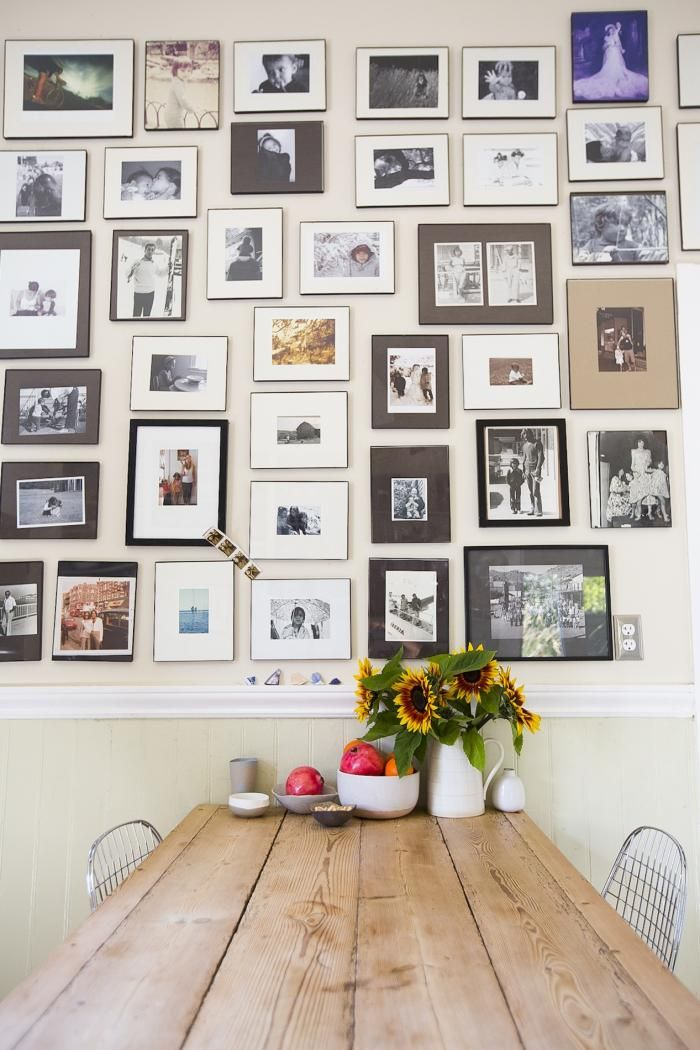 I like the idea of a photo wall like this.    West Marin's Accidental Doll Maker : Remodelista