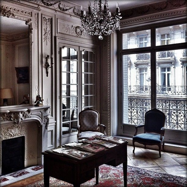 Mirrored doors reflect light coming through window---giving more interest and depth to the gray walls and woodwork.