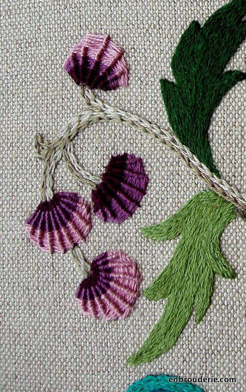These purple things supposedly represent berries, though I think they look like flowers. They're in a variant of spider-web stitch, which can make some really interesting textures. I finished off t...