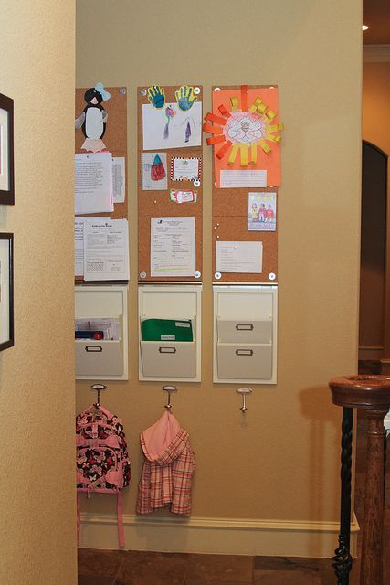 Family Organization. I love that theres a place to put the back pack. A place to hold papers for me to look at. And a place to hang there school accomplishments. It's perfect!! #home #decor