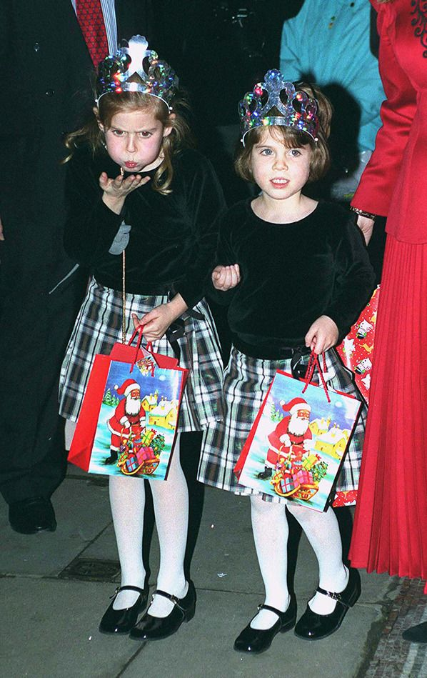 Princesses Beatrice and Eugenie attend a Christmas pantomime with their mother. via StyleList