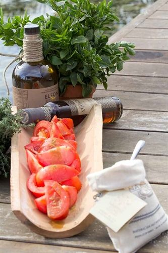 Tomato Salad with olive oil & cumin dressing by Navarino Icons. Using a spoon, blend all ingredients (except the tomatoes) in a small bowl in order to create a thick dressing. Cut tomatoes in slices and arrange on a serving plate.