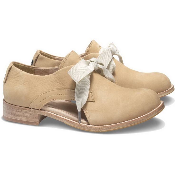 The Kay style just wants a tank and skirt to complete her look. This Cat  Footwear classic oxford shoe is visually striking with girly bows and cut  out surp