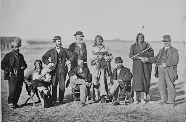 Standing L-R: Unknown, John Finn, Amos Bettelyoun, Old Man Afraid of his Horses (Oglala), Red Bear (Oglala), James Bordeaux (aka Bear) Sitting L-R: Packs His Drum (Oglala), William G. Bullock, Benjamin B. Mills - 1868 —