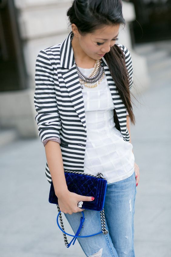 Striped blazer. jeans,navy blue clutch