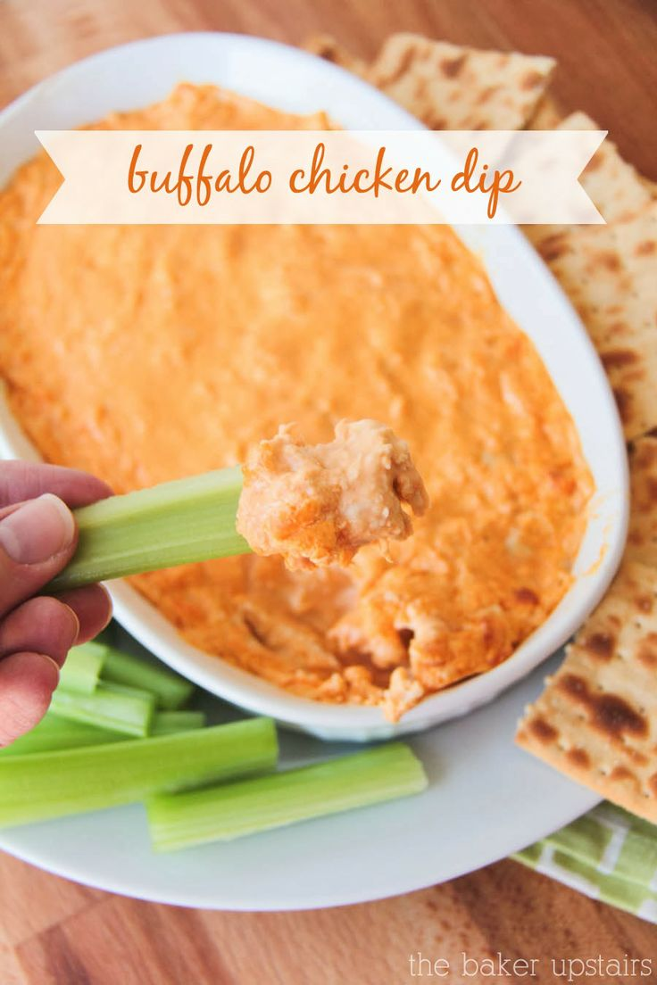 Buffalo chicken dip from The Baker Upstairs. This delicious cheesy and spicy dip is so easy to make and is a hit at any party! www.thebakerupstairs.com