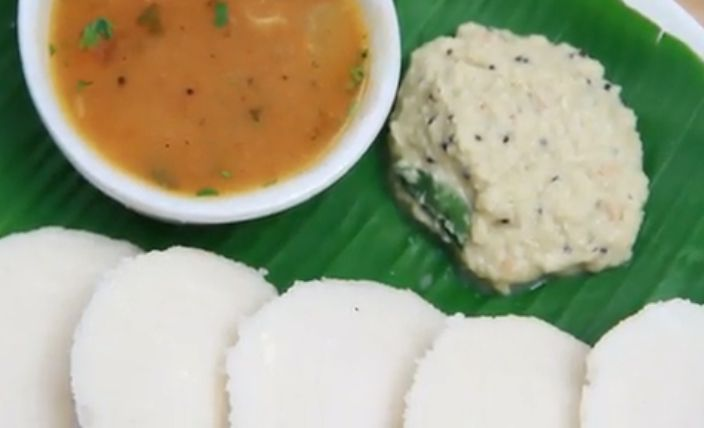 Idli, a famous South Indian food that is often served with a type of curry called sambar