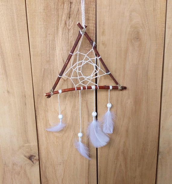 Check out this item in my Etsy shop https://www.etsy.com/listing/535080984/triangle-branch-wall-decor-boho-dream