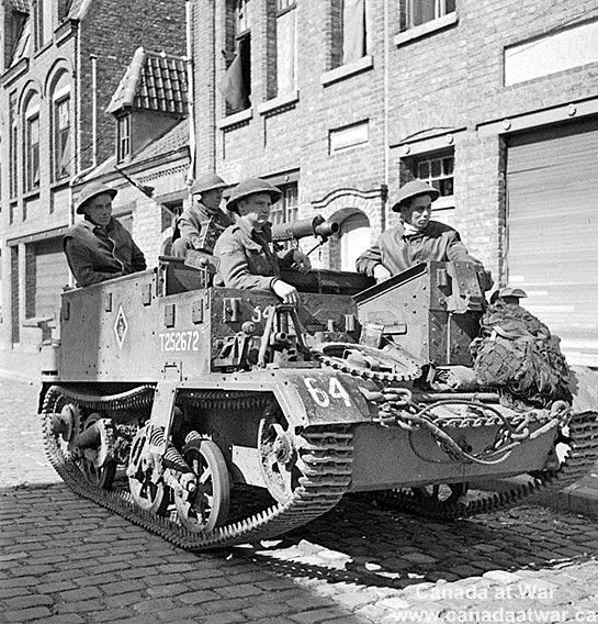 Infantrymen of the Toronto Scottish Regiment in their Universal Carrier waiting to move forward. September 9, 1944, Nieuwpoort