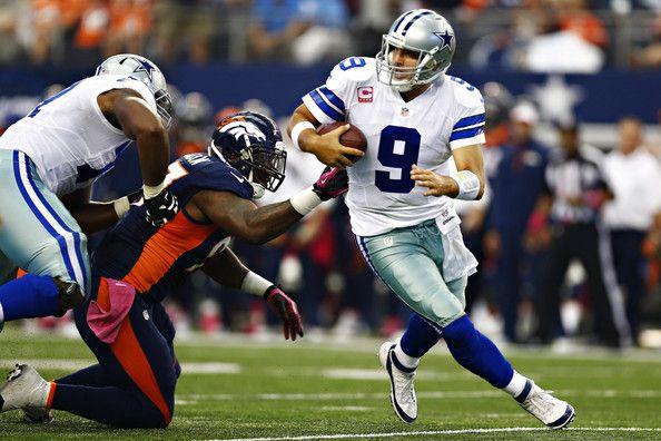 Tony Romo Photos Photos - Tony Romo #9 of the Dallas Cowboys scrambles to avoid the rush during a game against the Denver Broncos at  AT&T Stadium on October 6, 2013 in Arlington, Texas. - Denver Broncos v Dallas Cowboys