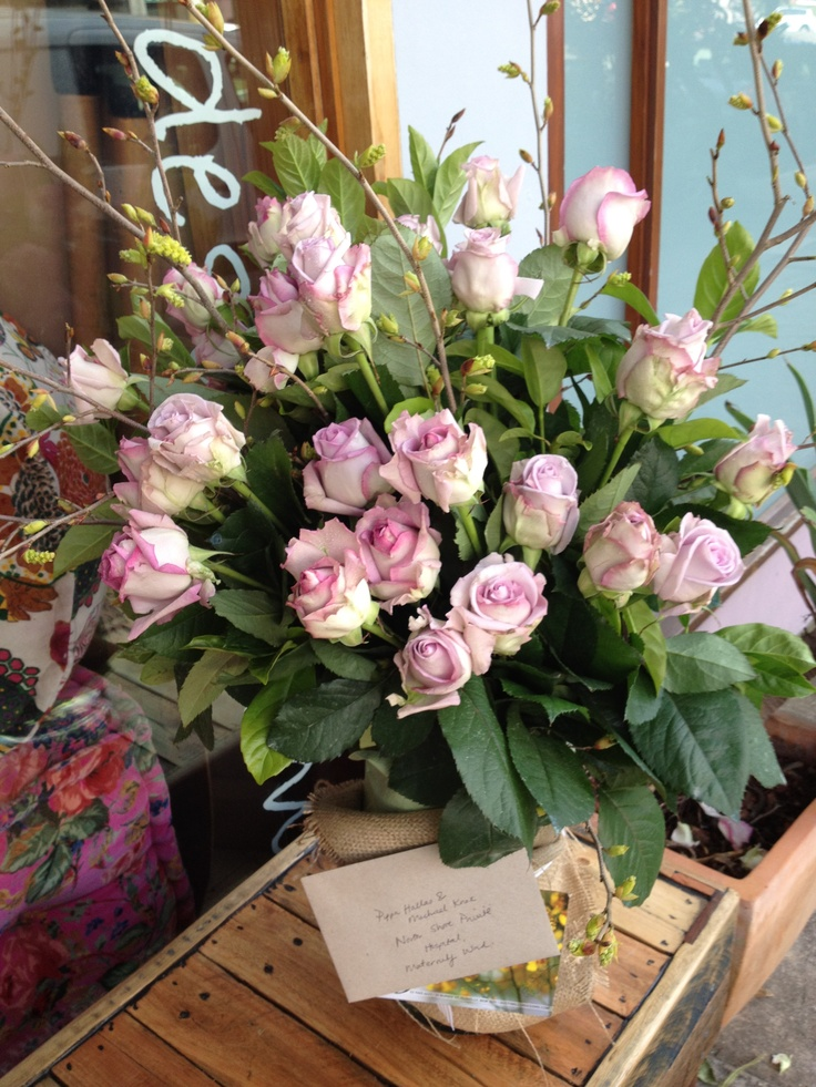 beautiful and big rose arrangement- dusty miller designs