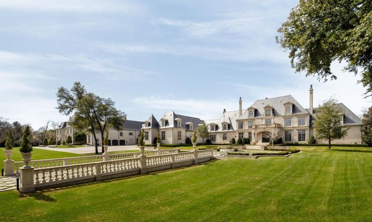 Two french chateau style mansions joined together by a 10 for Mansions in dallas tx