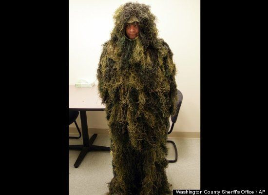 """Dumb Crime: Masterminds Need Not Apply  ~~  Camouflage might work well in nature, but it really stands out in the police station. Oregon investigators believe Gregory Liascos, 36, was wearing this """"ghillie"""" camouflage when he attempted to break into the Rice Northwest Museum of Rocks and Minerals last week. After setting off alarms, the suspect allegedly fled into a wooded area nearby. Officers only found Liascos when a police dog bit what appeared to be a patch of grass -- which yelped in…"""