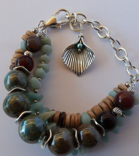 Check out this item in my Etsy shop https://www.etsy.com/au/listing/239283460/triple-strand-glazed-ceramic-beads-with