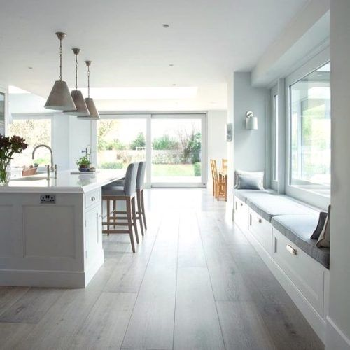 Bright and airy kitchen with gorgeous window seat.