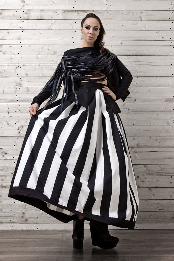 This is my maxi, high-waisted, monochrome take on the stylish A line skirts. The black and white horizontal stripes are a flattering pattern that elongates the legs and won't go unnoticed.   The attached large side pockets are the kind of quirky touch that I love to add to my pieces.