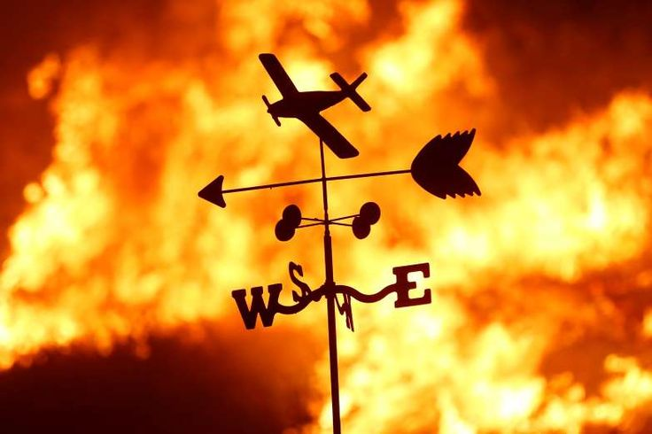 California Wildfires - December 5, 2017.  A weather vane is pictured on a ranch during the Creek Fire in the San Fernando Valley north of Los Angeles, Dec. 5 in Sylmar, California.