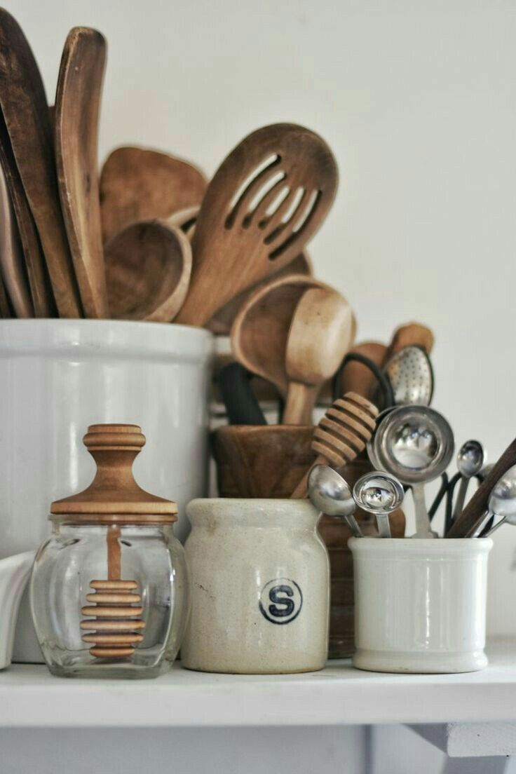 Wooden spoons, ceramic pots, glass jars and measuring spoons