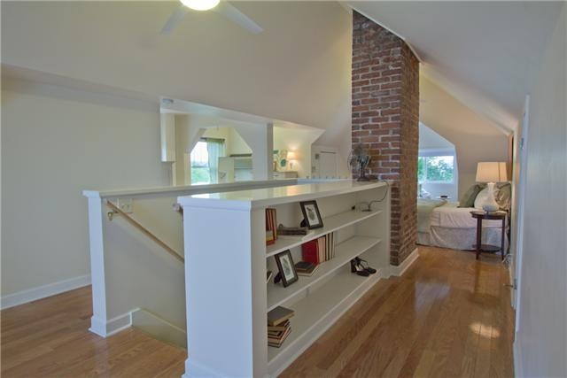 replace stair rails with bookshelf