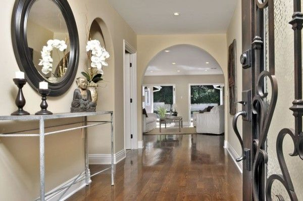 Entrance Hallway Lighting Ideas Using Recessed Led Light Fixture Above Small Buddha Statue Beside Wooden Candlestick Holders Over Narrow Hall Table also Entryway Storage Benches Entrance Hall Tree