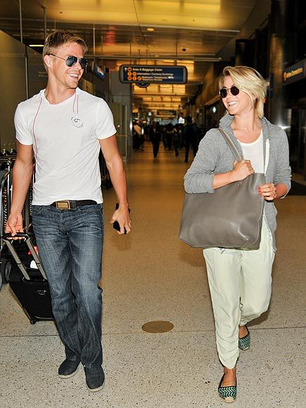 Siblings Derek and Julianne Hough, in chic shades, flashed almost identical smiles as they strolled through LAX! They practically look like twins!