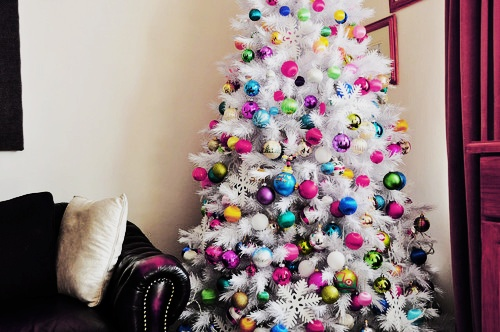 This white tree looks beautiful with multicoloured ornaments!