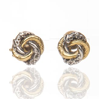 Tiny loveknot by Sophie Harley London.  Tiny loveknot stud earrings in silver & gold plate.