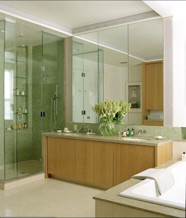 Wonderful Green Bathroom With Flower Pot On Bathroom Double Sink And Glass Shower Frame