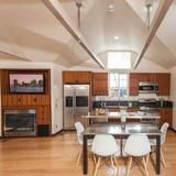 The kitchen/dining area in Vincent Kartheiser's tiny Hollywood bungalow has teak cabinetry and full-sized stainless steel appliances. | HGTV FrontDoor