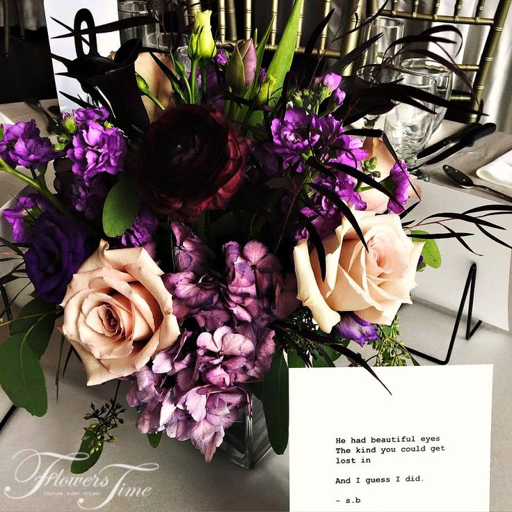50 shades of purple sophisticated centerpiece by Flowers Time