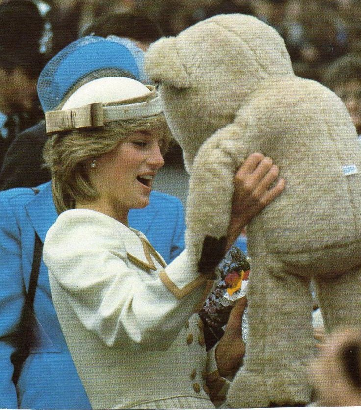 Princess Diana receives a big teddy bear.