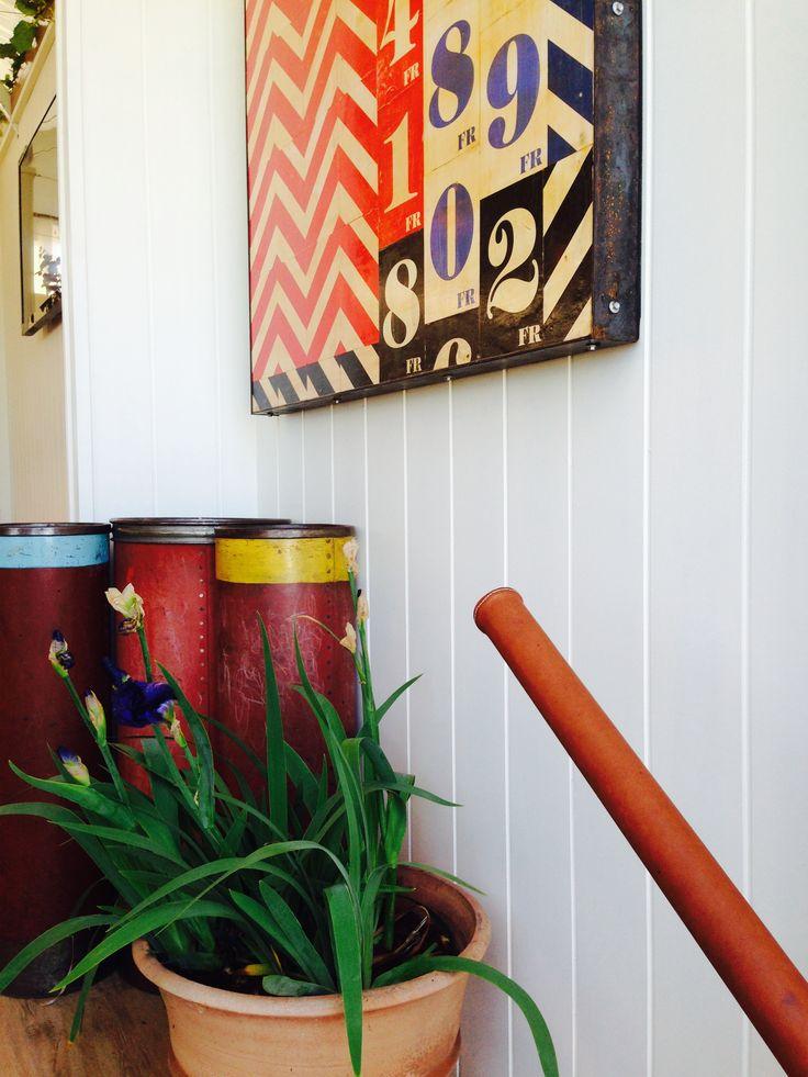 interior detail. leather stitched handrail, artwork by Guy Matthews