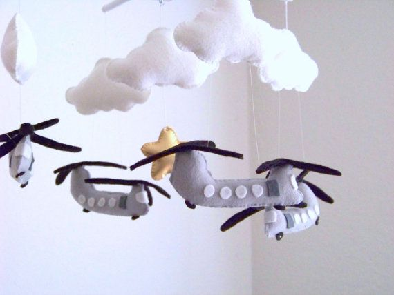This adorable chinook helicopter baby mobile will be a joy for your little baby to watch. This baby mobile features 4 gray chinook