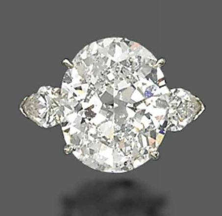 A DIAMOND RING, BY HARRY WINSTON   Set with an oval-shaped diamond, weighing approximately 8.41 carats, to the pear-shaped diamond shoulders, mounted in platinum, ring size 4 with ring sizer  Signed Winston for Harry Winston