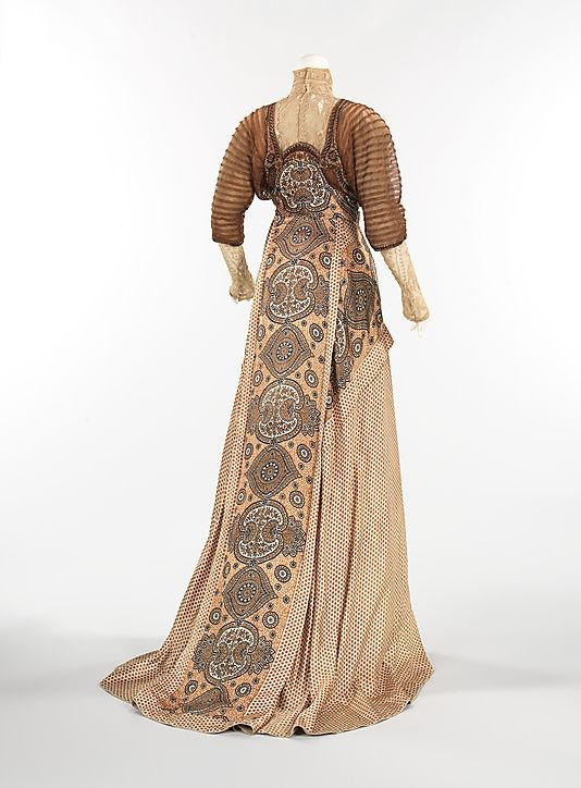 (2 of 2 photos) 1910 silk and linen evening dress by Weeks, French. Transitioning from the popular S-curve silhouette, this fashionable and eye-catching dress is more streamlined, with a slightly raised waist, introducing a more modern look. What is of most interest is the surprising combination of materials, using both polka dots and paisley patterns.