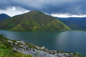 About Lake Toba Island In Samosir  Is the largest volcanic lake in the world. A miraculous place, one of the most beautiful place with the most incredible scenery in the whole planet.    It is a lake with 100 km long and 30 km wide, and 505 m. (1,666 ft.) at its deepest point, in the middle of the northern part of the Indonesian island of Sumatra with a surface elevation of about 900 m (3,000 feet).