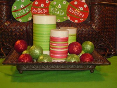 Fun. Easy. Cheap Christmas decor. Candles wrapped with ribbon and ornaments in tray